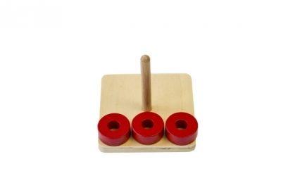 MMM012 - Discos en clavija vertical - Material Montessori. tres discos rojos fuera